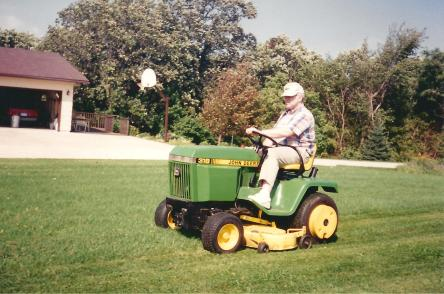 Don driving his John Deere
